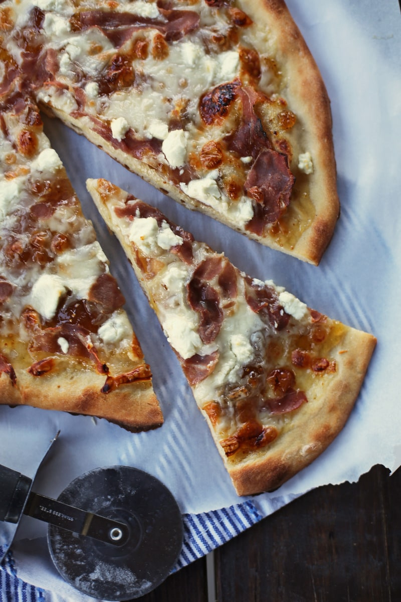 fig pizza with one slice cut out