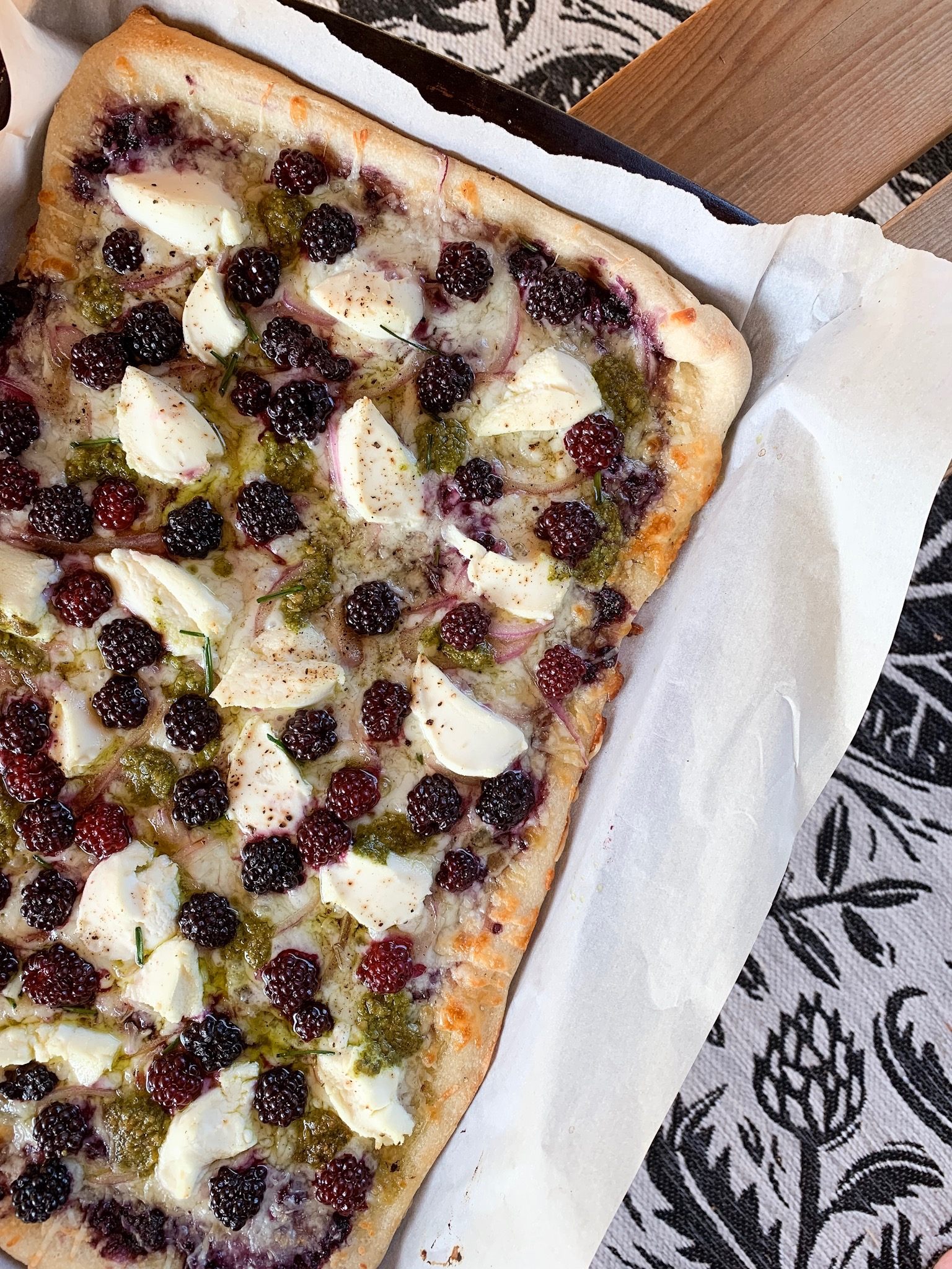 rectangle pizza with blackberries and cheese