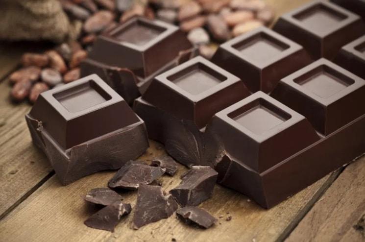 chunks of dark chocolate on a cutting board