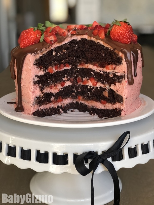 dark chocolate strawberry cake on a cake stand