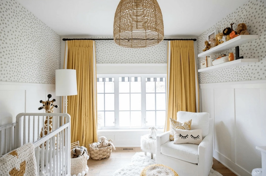 nursery with yellow curtains and white accents