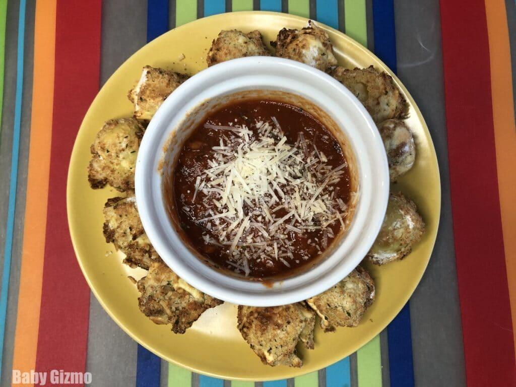 toasted tortellini in a circle around marinara sauce