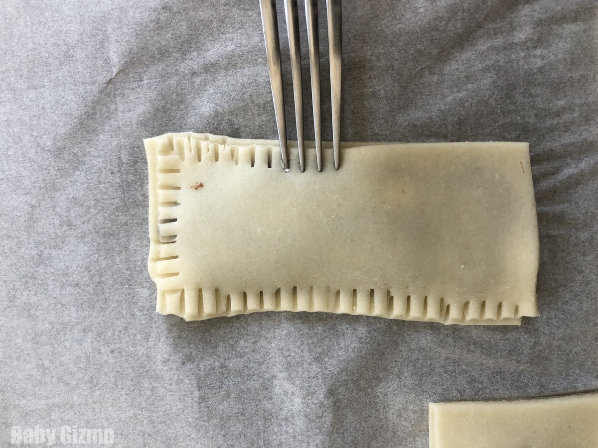 Sealing pie dough with a fork
