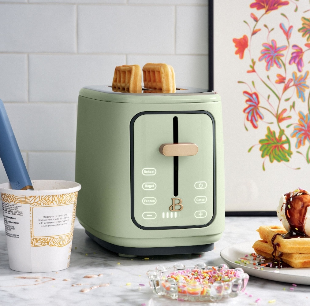sage green toaster with waffles