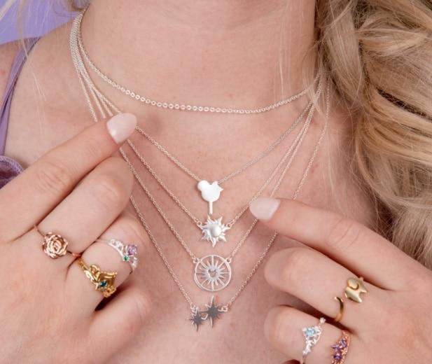 woman wearing disney jewelry