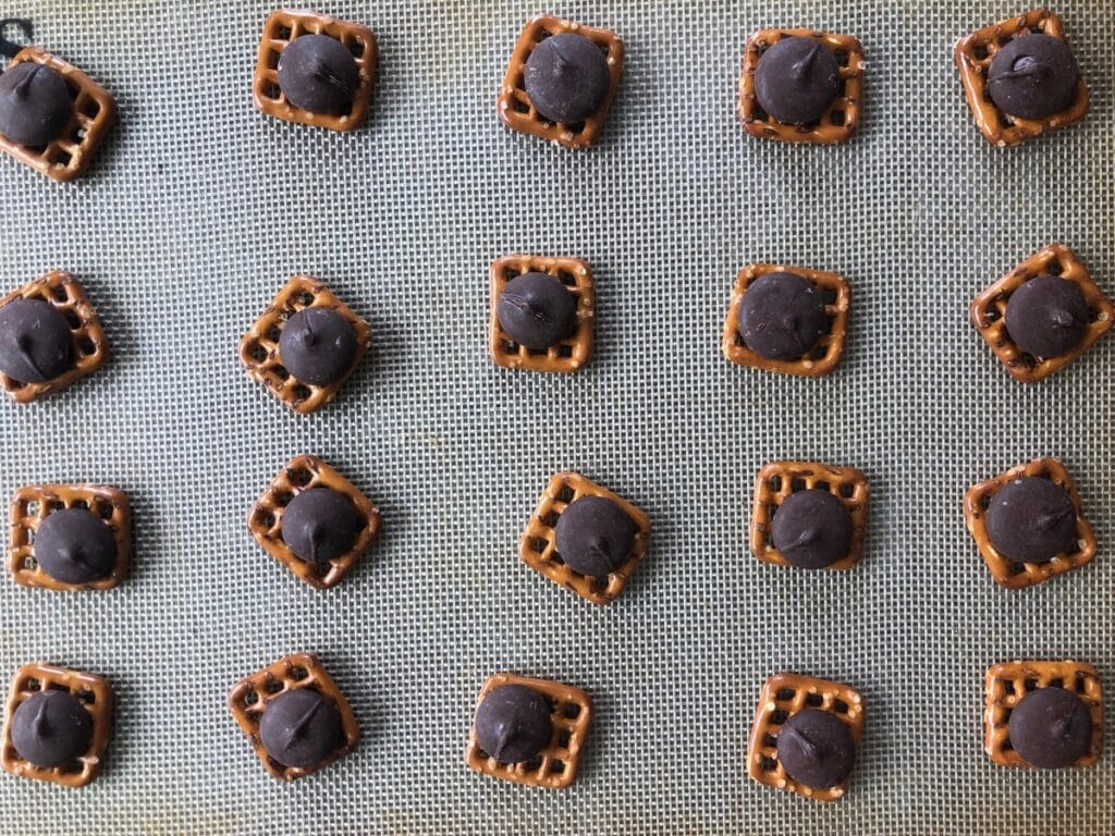 pretzels and chocolate on a baking sheet
