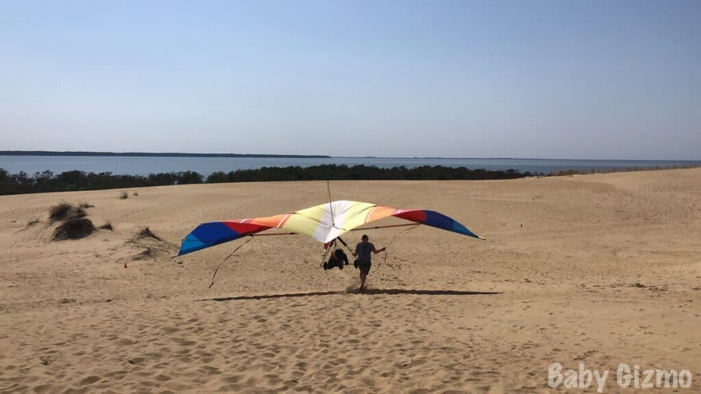 hang gliding over dunes