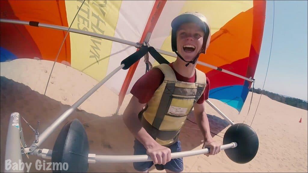 Teen Boy hang gliding