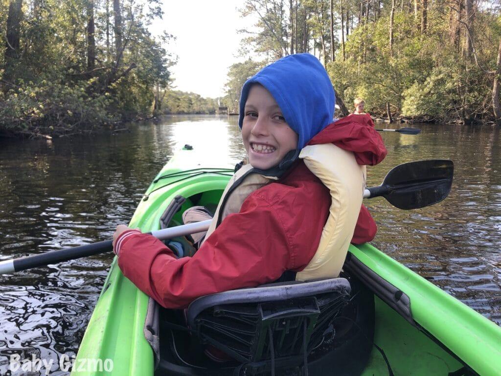 boy kayaking in outer banks