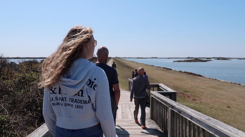 family walking in bird sanctuary