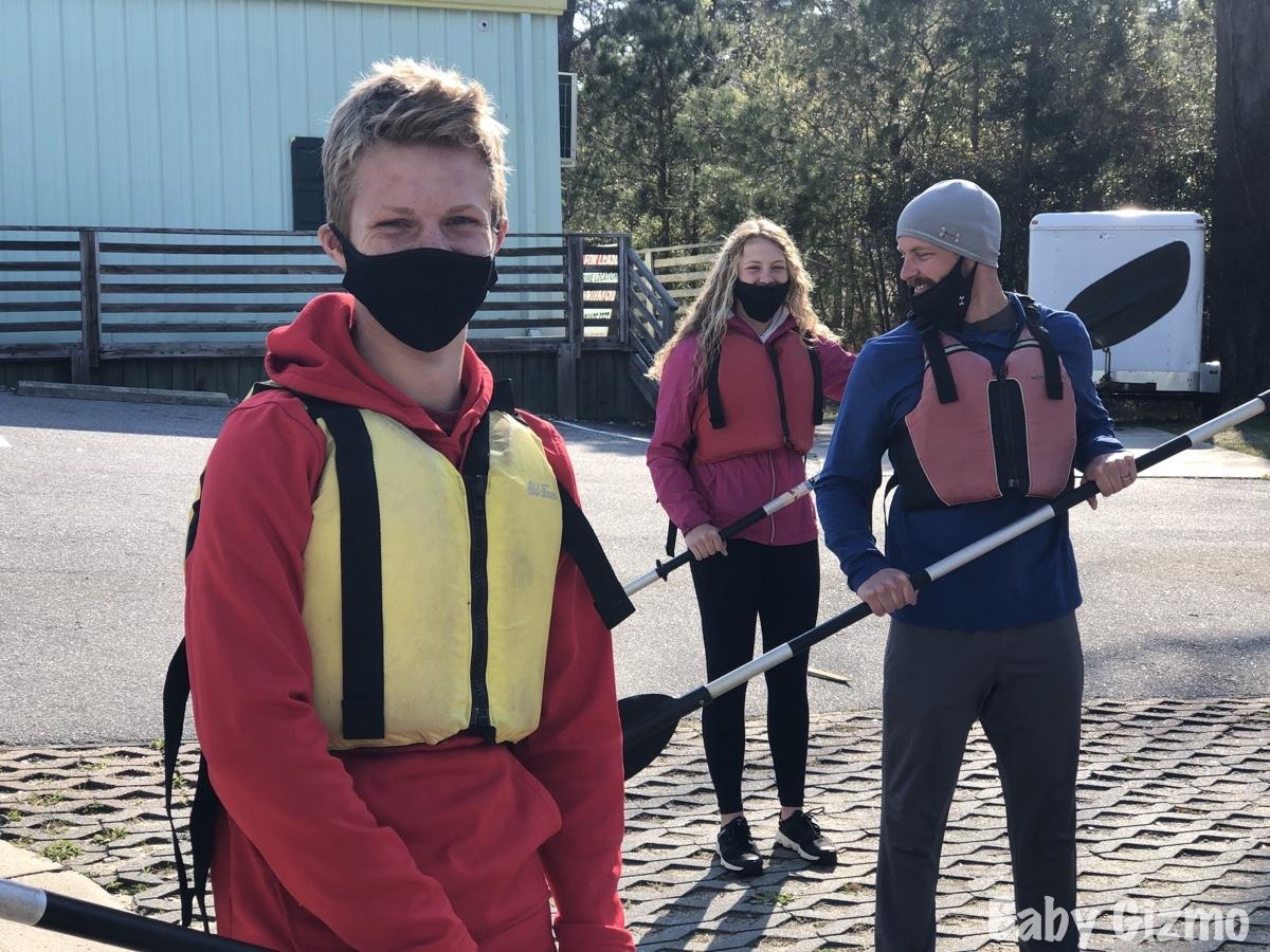 teens and dad kayaking