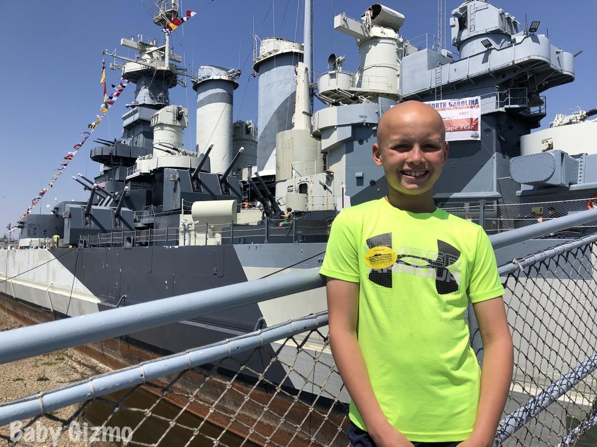 boy in front of wilmington battleship