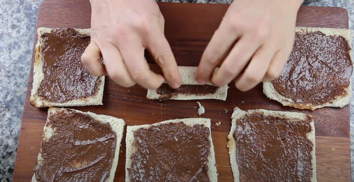 rolling nutella on bread