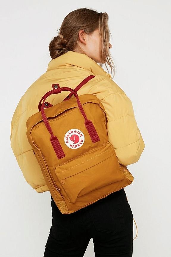 model holding fjallraven kanken backpack