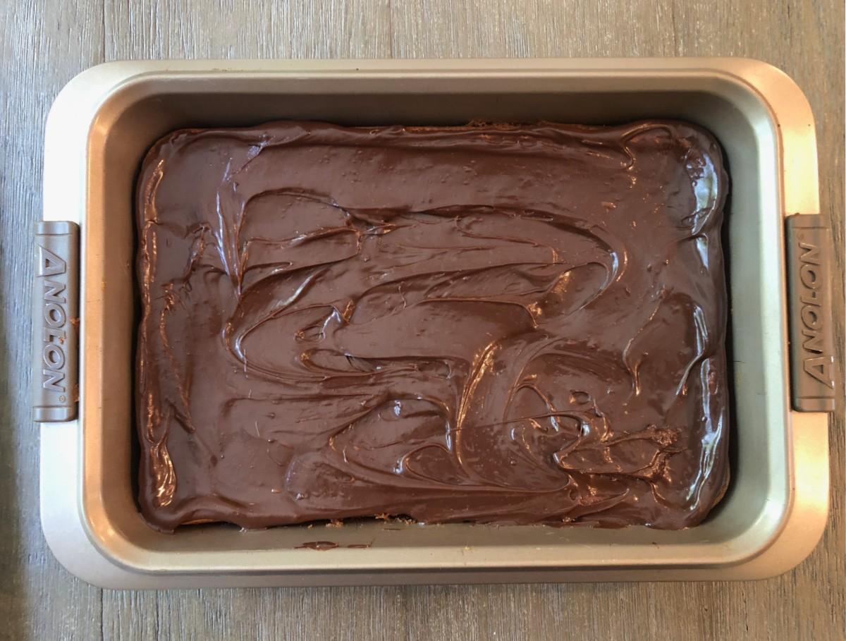 fudge over cookies in a pan