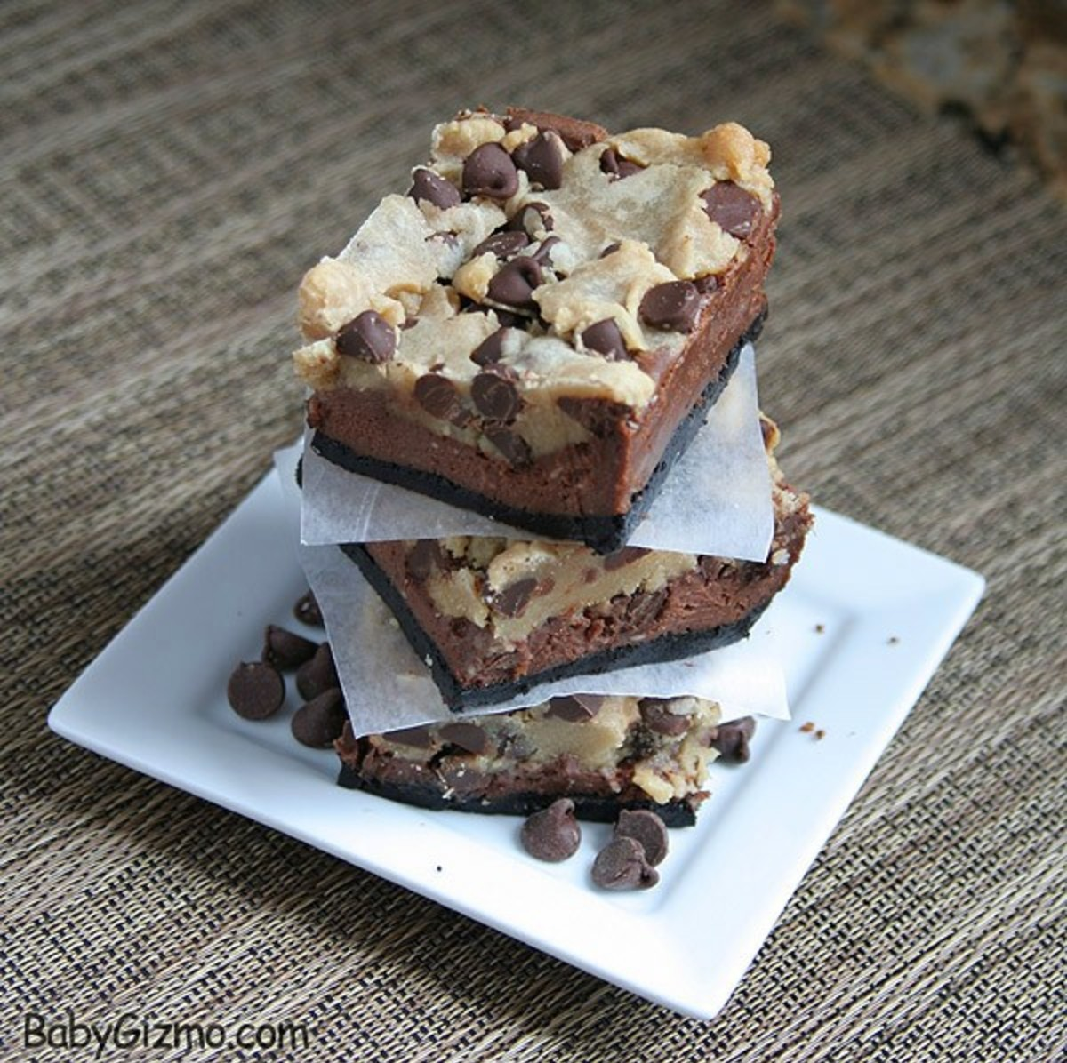 3 Chocolate Chip Chocolate Cheesecake Bars on a white plate
