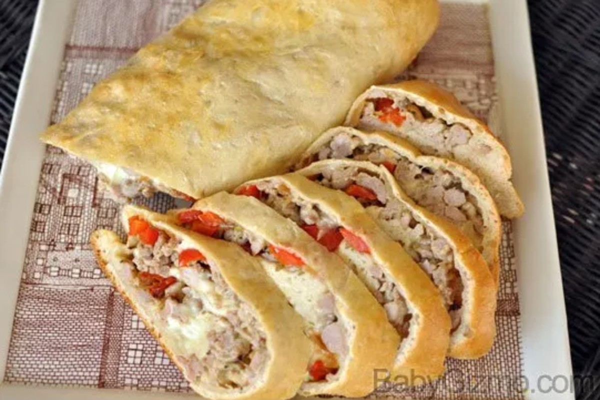 Sausage and Pepper Stromboli sliced on plate