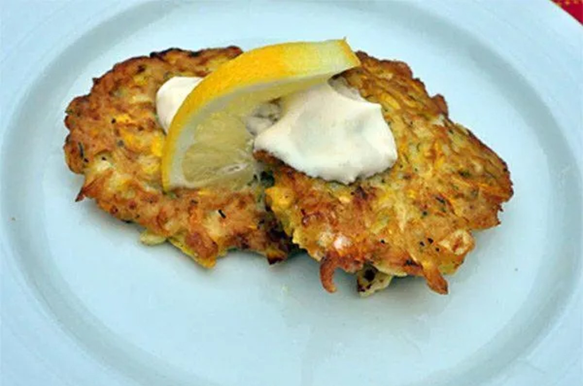 Summer Squash, Corn and Cheddar Fritters on a light blue plate