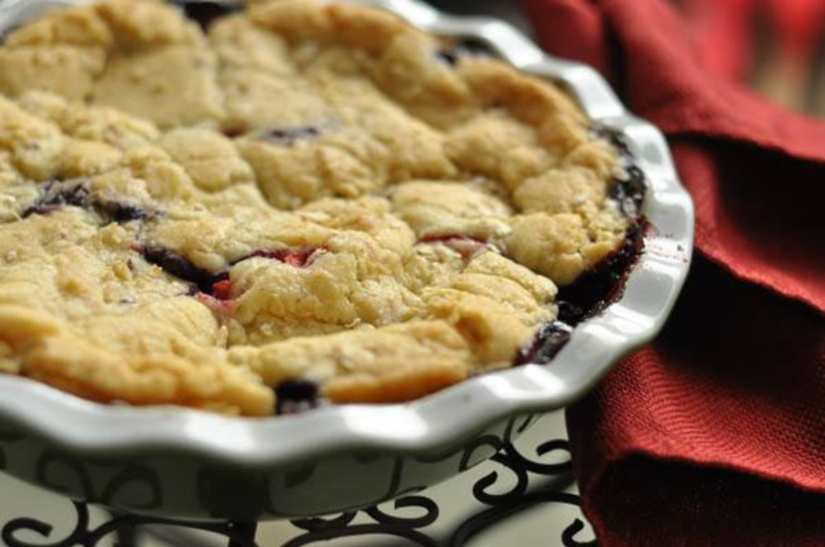 Sugar cookie summer berry crisp with a red towel on the right