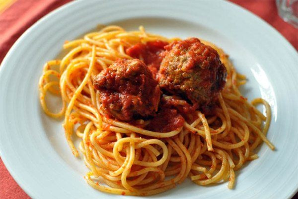 meatballs in spaghetti on a white plate
