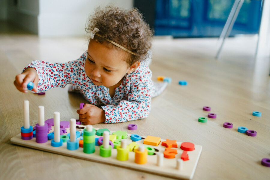 baby girl playing with letters
