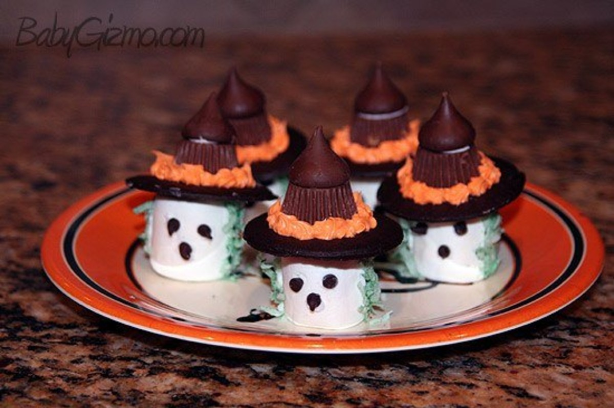 Marshmallow Witches on a orange plate