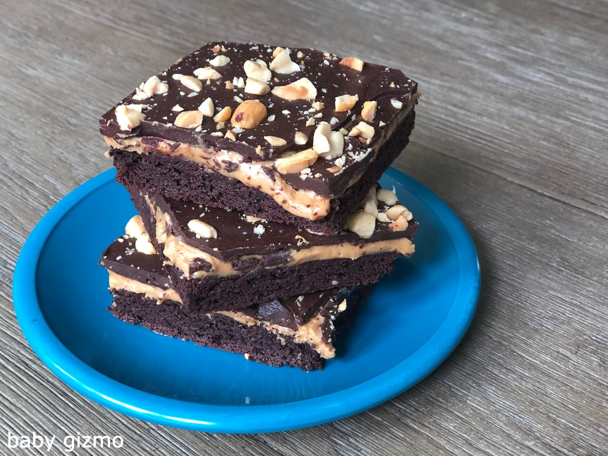 peanut butter cup cookie bars stacked on blue plate