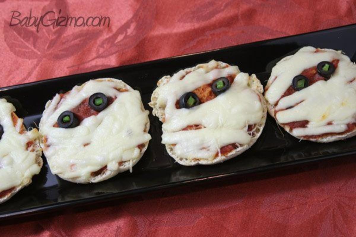 Pizza Mummies on a black plate