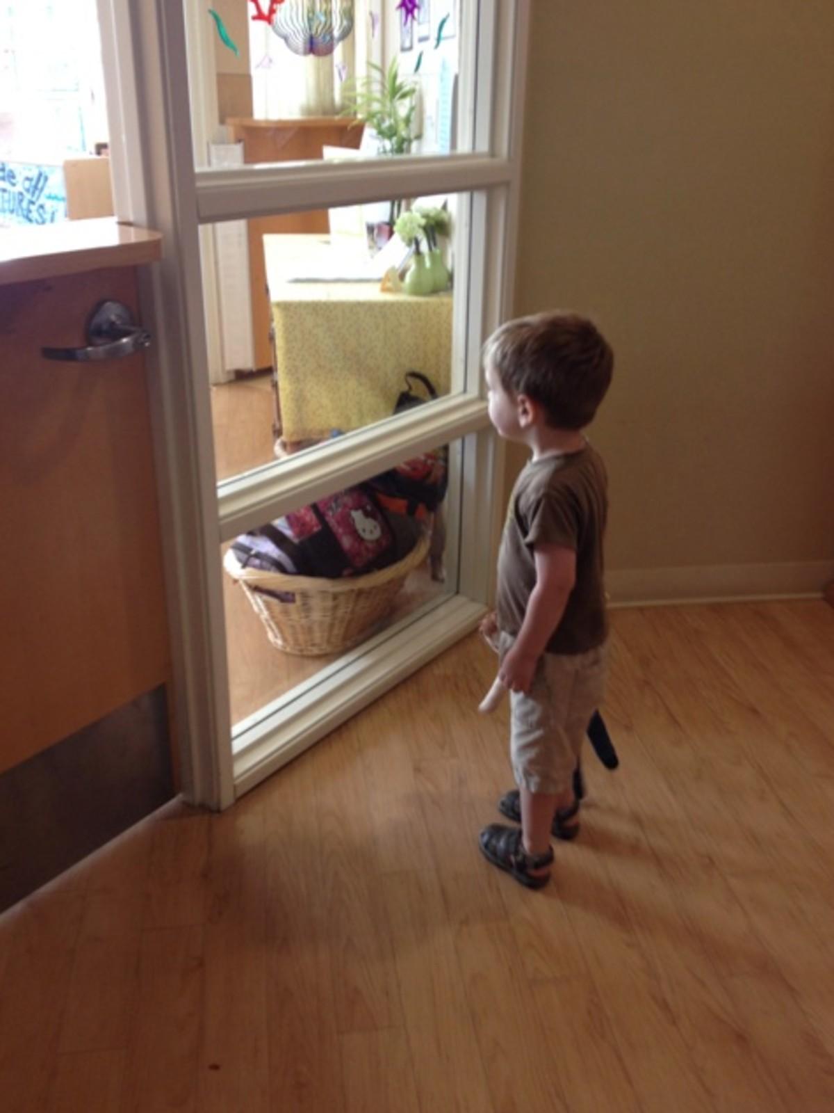 preschooler looking in window
